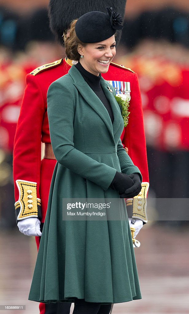 <a gi-track='captionPersonalityLinkClicked' href=/galleries/search?phrase=Catherine+-+Duchess+of+Cambridge&family=editorial&specificpeople=542588 ng-click='$event.stopPropagation()'>Catherine</a>, Duchess of Cambridge presents sprigs of Shamrock to Officers and Guardsmen of the 1st Battalion Irish Guards during the St Patrick's Day Parade at Mons Barracks on March 17, 2013 in Aldershot, England.