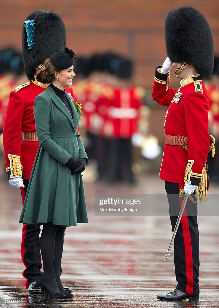 Catherine, Duchess of Cambridge presents sprigs of Shamrock to Officers and Guardsmen of the 1st Battalion Irish Guards during the St Patrick's Day Parade at Mons Barracks on March 17, 2013 in Aldershot, England.