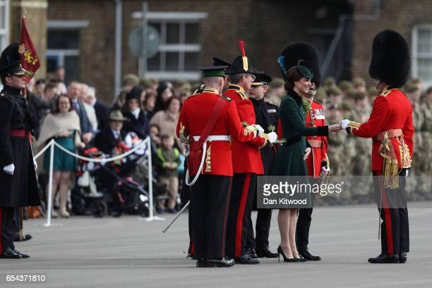 Catherine Duchess of Cambridge presents the 1st Battalion Irish Guardsmen with shamrocks during the annual Irish Guards' St Patrick's Day Parade at...