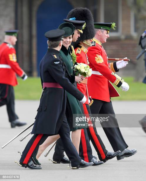 Catherine Duchess of Cambridge presents the 1st Battalion Irish Guardsmen with shamrocks during the annual Irish Guards St Patrick's Day Parade at...