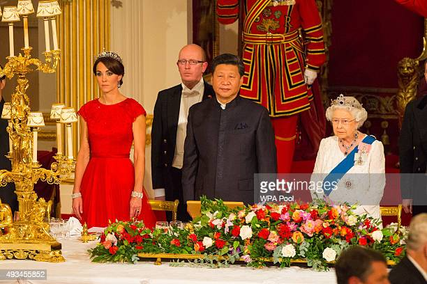 Catherine Duchess of Cambridge President of China Xi Jinping and Britain's Queen Elizabeth II attend a state banquet at Buckingham Palace on October...