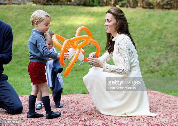 Catherine Duchess of Cambridge Prince George of Cambridge and Princess Charlotte of Cambridge attend a children's party for Military families during...