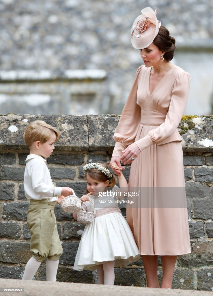 Catherine, Duchess of Cambridge, Prince George of Cambridge and Princess Charlotte of Cambridge attend the wedding of Pippa Middleton and James Matthews at St Mark's Church on May 20, 2017 in Englefield Green, England.