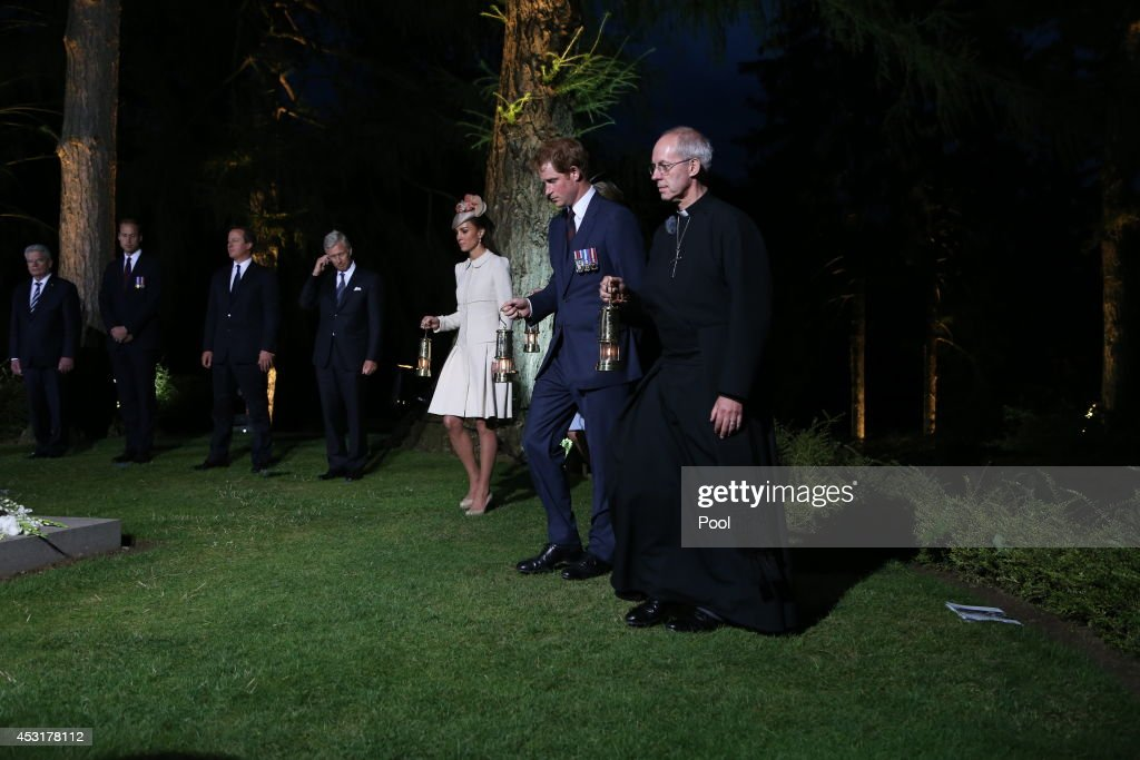 Catherine, Duchess of Cambridge, <a gi-track='captionPersonalityLinkClicked' href=/galleries/search?phrase=Prince+Harry&family=editorial&specificpeople=178173 ng-click='$event.stopPropagation()'>Prince Harry</a> and The Archbishop of Canterbury, <a gi-track='captionPersonalityLinkClicked' href=/galleries/search?phrase=Justin+Welby&family=editorial&specificpeople=9960447 ng-click='$event.stopPropagation()'>Justin Welby</a> carry lamps during a ceremony at St Symphorien Military Cemetery on August 4, 2014 in Mons, Belgium. Monday 4th August marks the 100th Anniversary of Great Britain declaring war on Germany. In 1914 British Prime Minister Herbert Asquith announced at 11pm that Britain was to enter the war after Germany had violated Belgium's neutrality. The First World War or the Great War lasted until 11 November 1918 and is recognised as one of the deadliest historical conflicts with millions of casualties. A series of events commemorating the 100th Anniversary are taking place throughout the day.