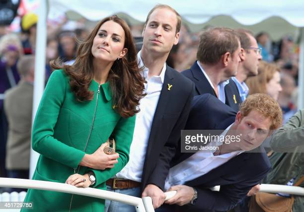 Catherine Duchess of Cambridge Prince William Duke of Cambridge and Prince Harry watch riders at the finish line of Stage 1 of the Tour De France on...