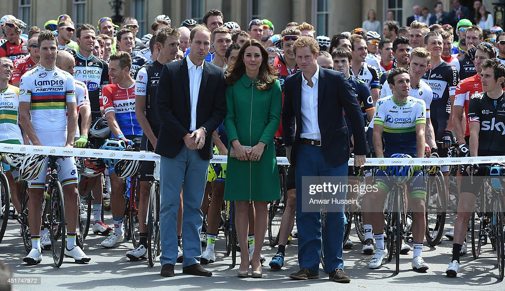 Catherine Duchess of Cambridge Prince William Duke of Cambridge and Prince Harry pose with cyclists before cutting cut the ribbon at the official...