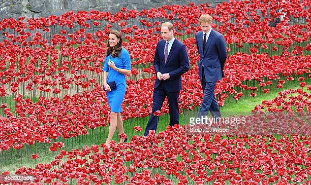 Catherine Duchess of Cambridge Prince William Duke of Cambridge and Prince Harry visit the Tower of London's Ceramic Poppy Field at The Tower of...