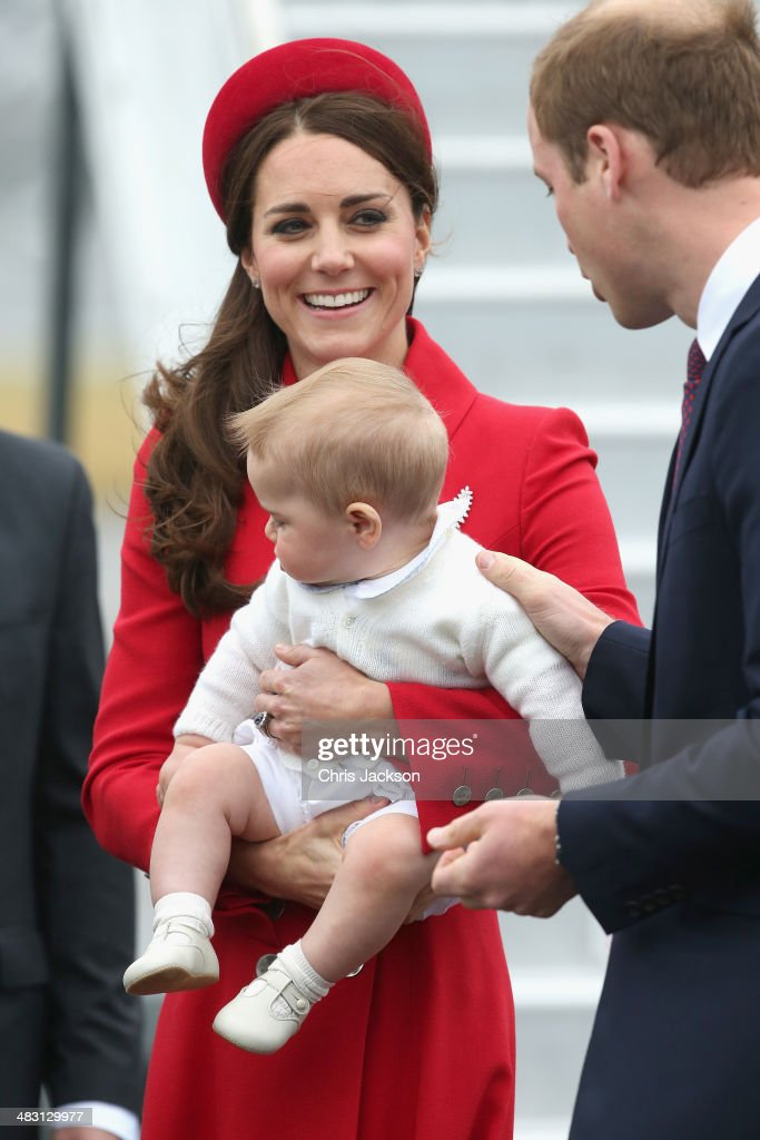<a gi-track='captionPersonalityLinkClicked' href=/galleries/search?phrase=Catherine+-+Duchess+of+Cambridge&family=editorial&specificpeople=542588 ng-click='$event.stopPropagation()'>Catherine</a>, Duchess of Cambridge, Prince William, Duke of Cambridge and <a gi-track='captionPersonalityLinkClicked' href=/galleries/search?phrase=Prince+George+of+Cambridge&family=editorial&specificpeople=11176510 ng-click='$event.stopPropagation()'>Prince George of Cambridge</a> arrive at Wellington Military Terminal on an RNZAF 757 from Sydney on April 7, 2014 in Wellington, New Zealand. The Royal Family have arrived in New Zealand for the first day of a Royal Tour to New Zealand and Australia. Over a period of three weeks the Royal trio will visit 12 Cities in New Zealand and Australia taking part in activities as wide ranging as a yacht race in Auckland Harbour, paying their respects to victims of the 2011 earthquake in Christchurch and visiting Ayres Rock in Australia.