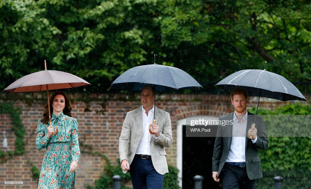 Catherine, Duchess of Cambridge, Prince William, Duke of Cambridge and Prince Harry are seen during a visit to The Sunken Garden at Kensington Palace on August 30, 2017 in London, England. The garden has been transformed into a White Garden dedicated in the memory of Princess Diana, mother of The Duke of Cambridge and Prince Harry.