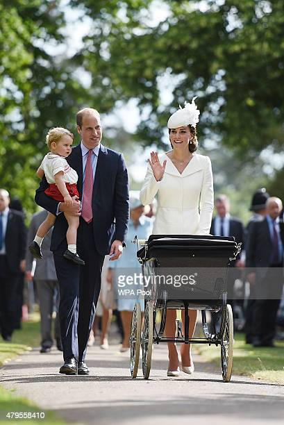 Catherine Duchess of Cambridge Prince William Duke of Cambridge Princess Charlotte of Cambridge and Prince George of Cambridge wave to crowds as they...