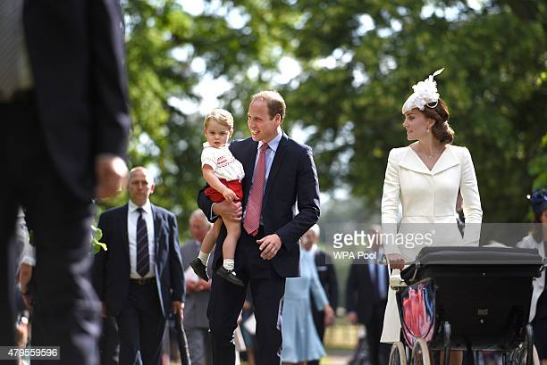 Catherine Duchess of Cambridge Prince William Duke of Cambridge Princess Charlotte of Cambridge and Prince George of Cambridge walk past crowds as...