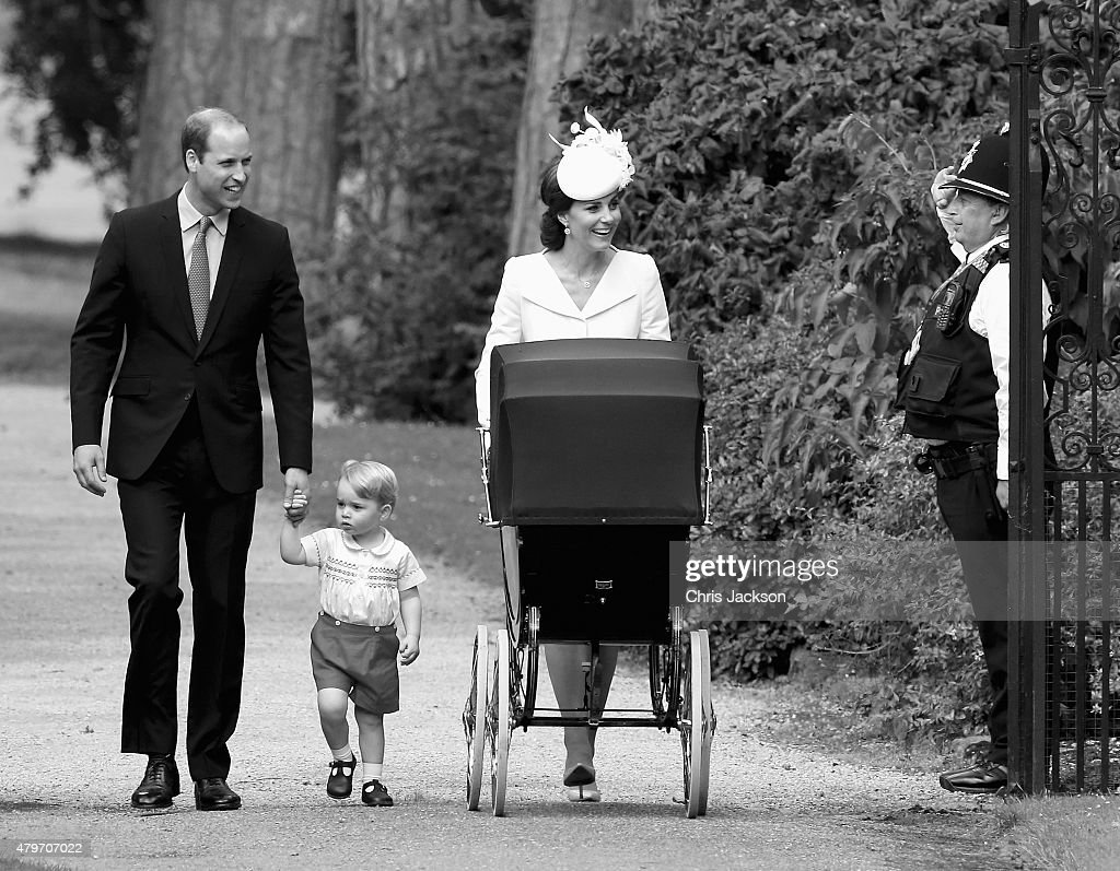 Catherine, Duchess of Cambridge, Prince William, Duke of Cambridge, Princess Charlotte of Cambridge and Prince George of Cambridge are saluted by a policeman as they arrive at the Church of St Mary Magdalene on the Sandringham Estate for the Christening of Princess Charlotte of Cambridge on July 5, 2015 in King's Lynn, England.