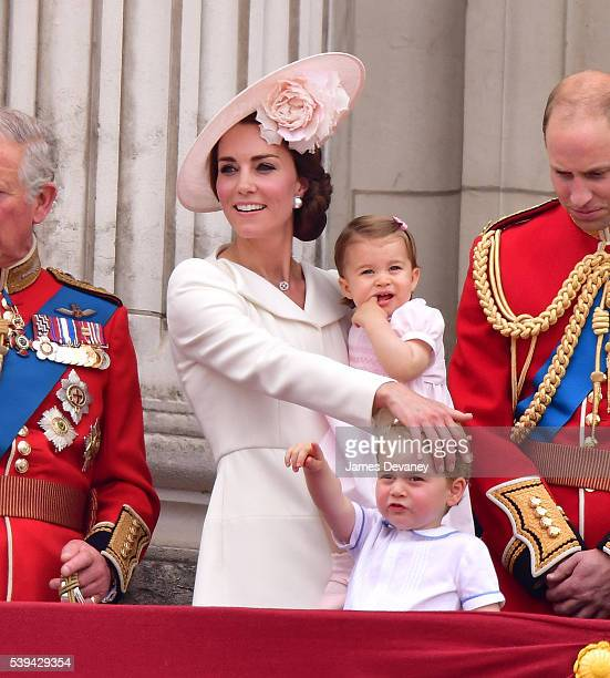 Catherine Duchess of Cambridge Princess Charlotte and Prince George stand on the balcony during the Trooping the Colour this year marking the Queen's...