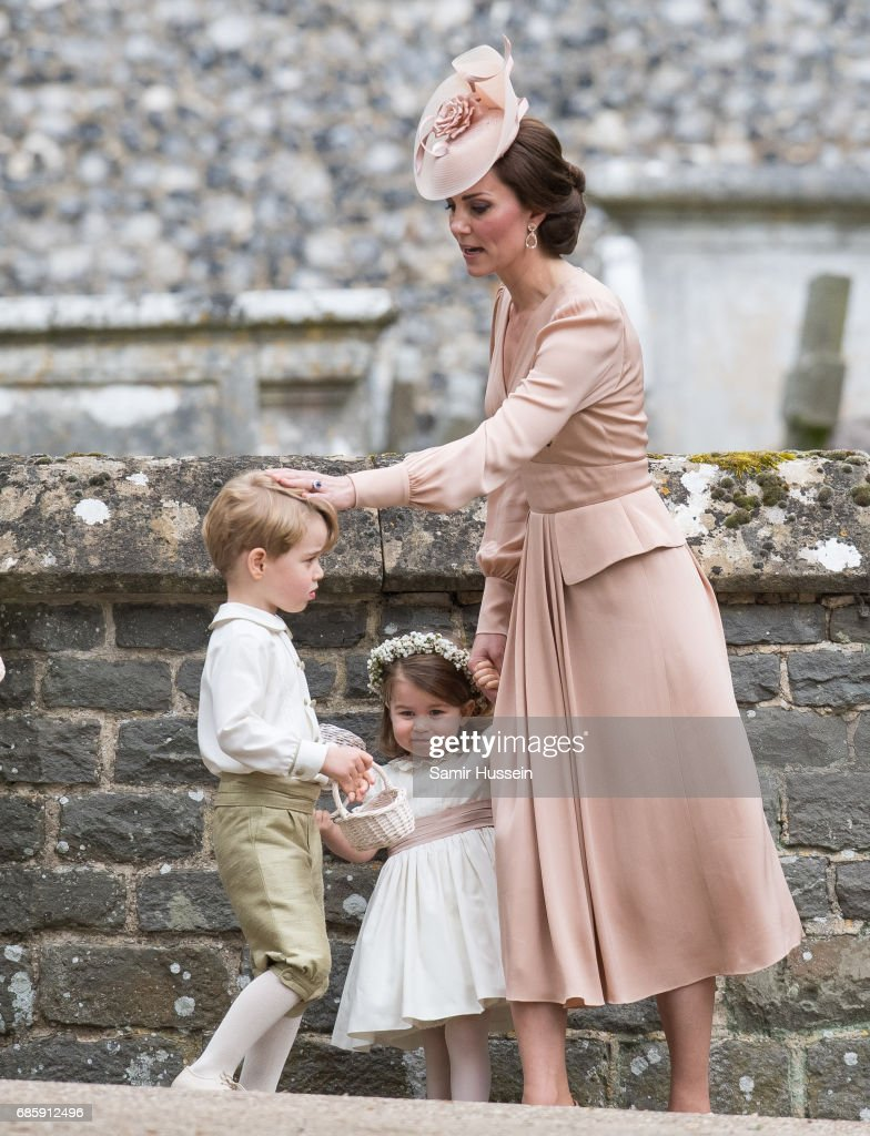 Catherine, Duchess of Cambridge, Princess Charlotte of Cambridge and Prince George of Cambridge attend the wedding Of Pippa Middleton and James Matthews at St Mark's Church on May 20, 2017 in Englefield Green, England.