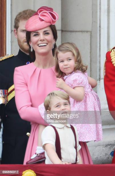 Catherine Duchess of Cambridge Princess Charlotte of Cambridge and Prince George of Cambridge look out from the balcony of Buckingham Palace during...