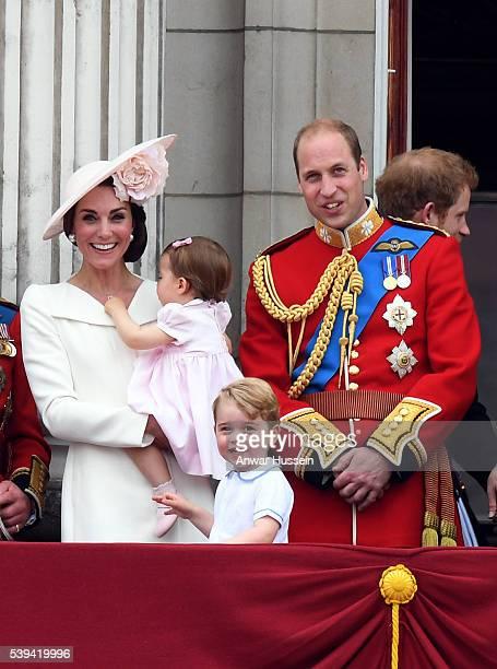 Catherine Duchess of Cambridge Princess Charlotte of Cambridge Prince George and Prince William Duke of Cambridge appear on the balcony of Buckingham...