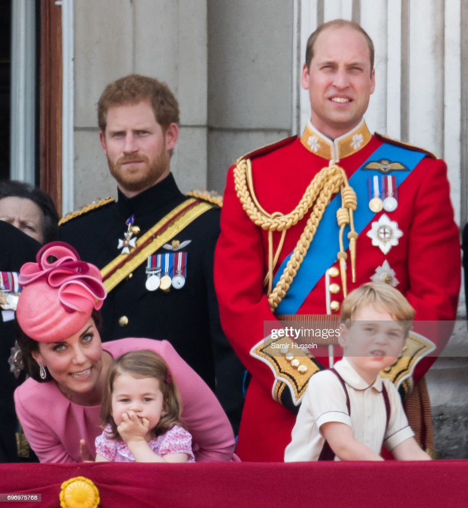 Catherine, Duchess of Cambridge, Princess Charlotte of Cambridge, Prince Harry, Prince George of Cambridge and Prince William, Duke of Cambridge look on from the balcony during the annual Trooping The Colour parade on June 17, 2017 in London, England.
