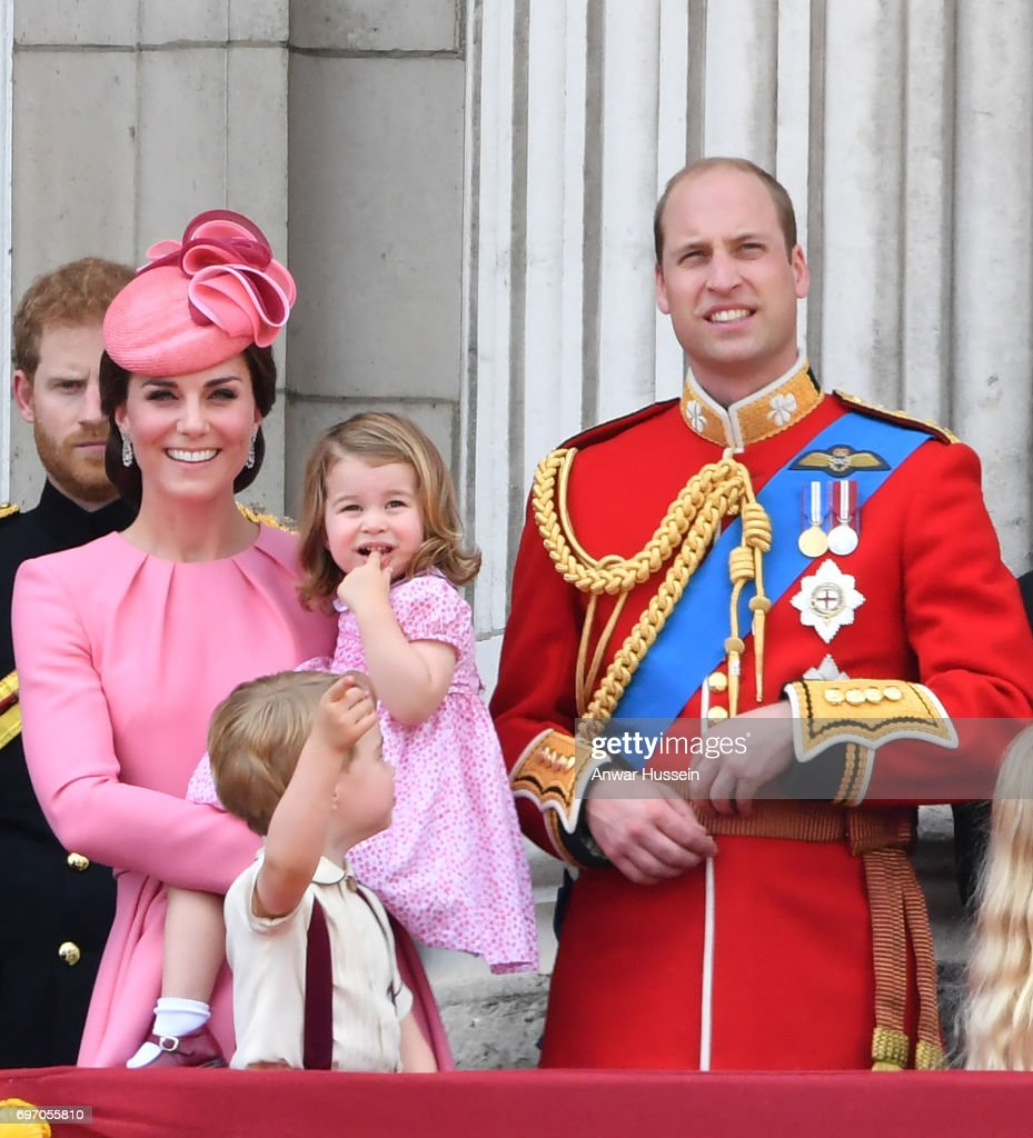 Catherine, Duchess of Cambridge, Princess Charlotte of Cambridge, Prince George of Cambridge and Prince William, Duke of Cambridge look out from the balcony of Buckingham Palace during the annual Trooping the Colour parade on June 17, 2017 in London, England.