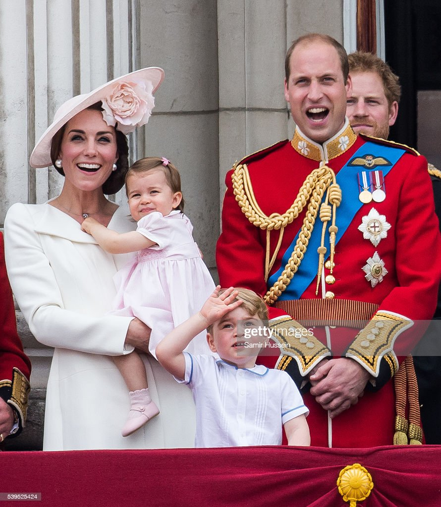 Catherine, Duchess of Cambridge, Princess Charlotte, Prince George, Prince William, Duke of Cambridge stand on the balcony during the Trooping the Colour, this year marking the Queen's official 90th birthday at The Mall on June 11, 2016 in London, England. The ceremony is Queen Elizabeth II's annual birthday parade and dates back to the time of Charles II in the 17th Century when the Colours of a regiment were used as a rallying point in battle.