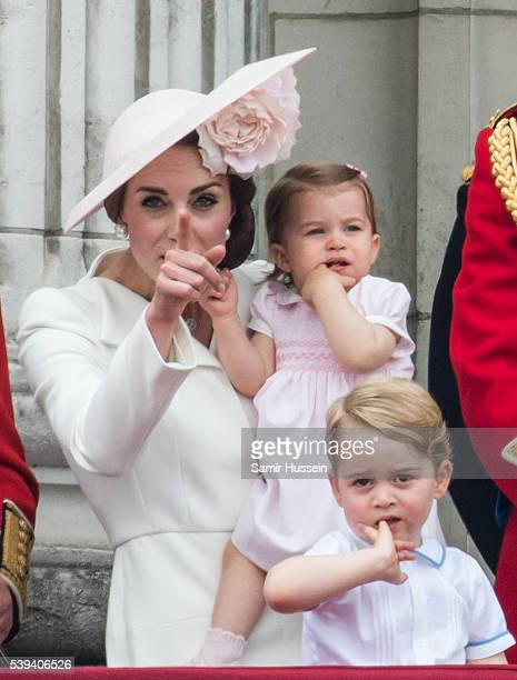 Catherine Duchess of Cambridge Princess Charlotte Prince George stand on the balcony during the Trooping the Colour this year marking the Queen's...