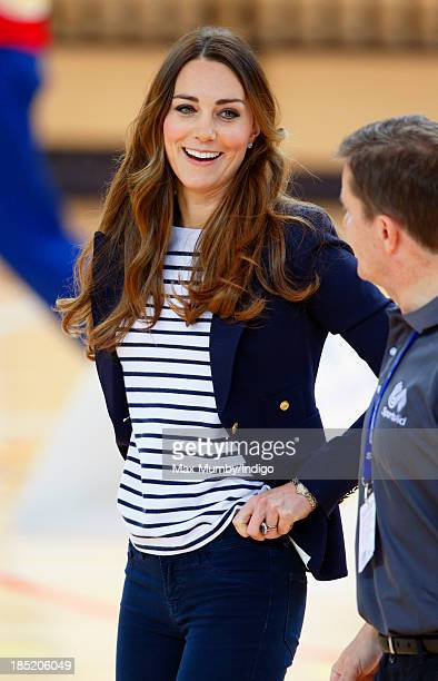 Catherine Duchess of Cambridge pulls up her trousers after playing volleyball as she attends a SportsAid Athlete Workshop in the Copper Box Arena at...