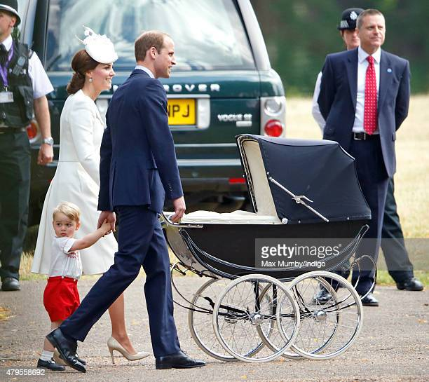 Catherine Duchess of Cambridge pushes daughter Princess Charlotte of Cambridge in her pram as she Prince William Duke of Cambridge and Prince George...