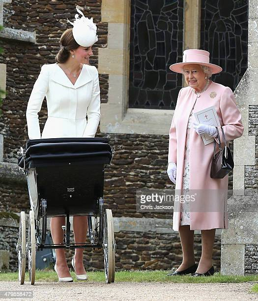 Catherine Duchess of Cambridge pushes Princess Charlotte of Cambridge in her pram as Queen Elizabeth II looks on as they leave the Church of St Mary...