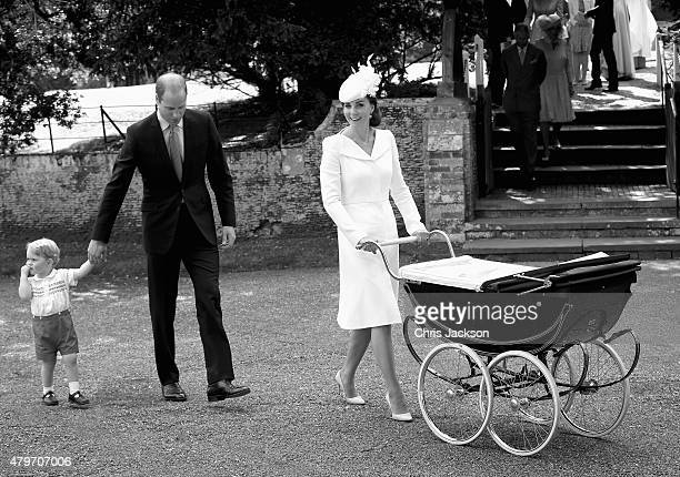 Catherine Duchess of Cambridge pushes Princess Charlotte of Cambridge in her pram as Prince William Duke of Cambridge and Prince George of Cambridge...