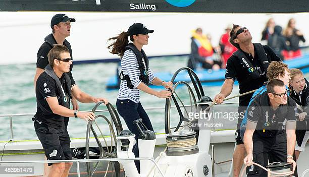 Catherine Duchess of Cambridge races the New Zealand's Americas Cup Team yacht during their visit to Auckland Harbour on April 11 2014 in Auckland...
