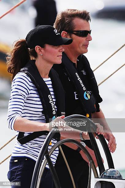 Catherine Duchess of Cambridge races with Team New Zealand skipper Dean Barker during a match race on the Waitemata Harbour on April 11 2014 in...