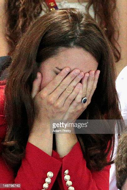 Catherine Duchess of Cambridge reacts during the swimming finals session on Day 7 of the London 2012 Olympic Games at the Aquatics Centre on August 3...