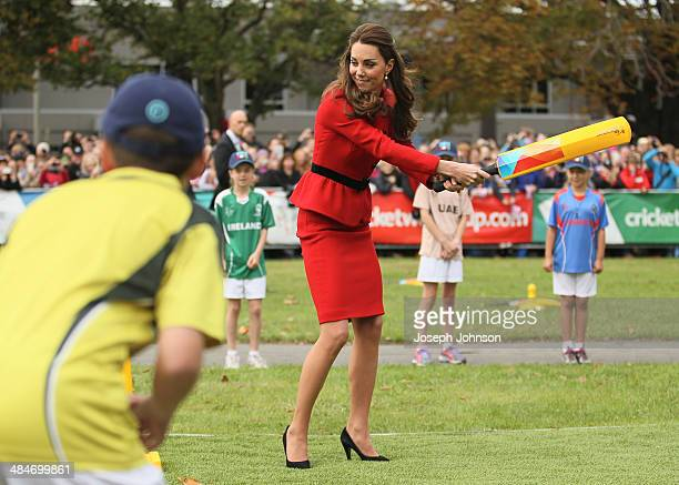 Catherine Duchess of Cambridge reacts to a bowl from Prince William Duke of Cambridge while batting during a game of cricket during the countdown to...