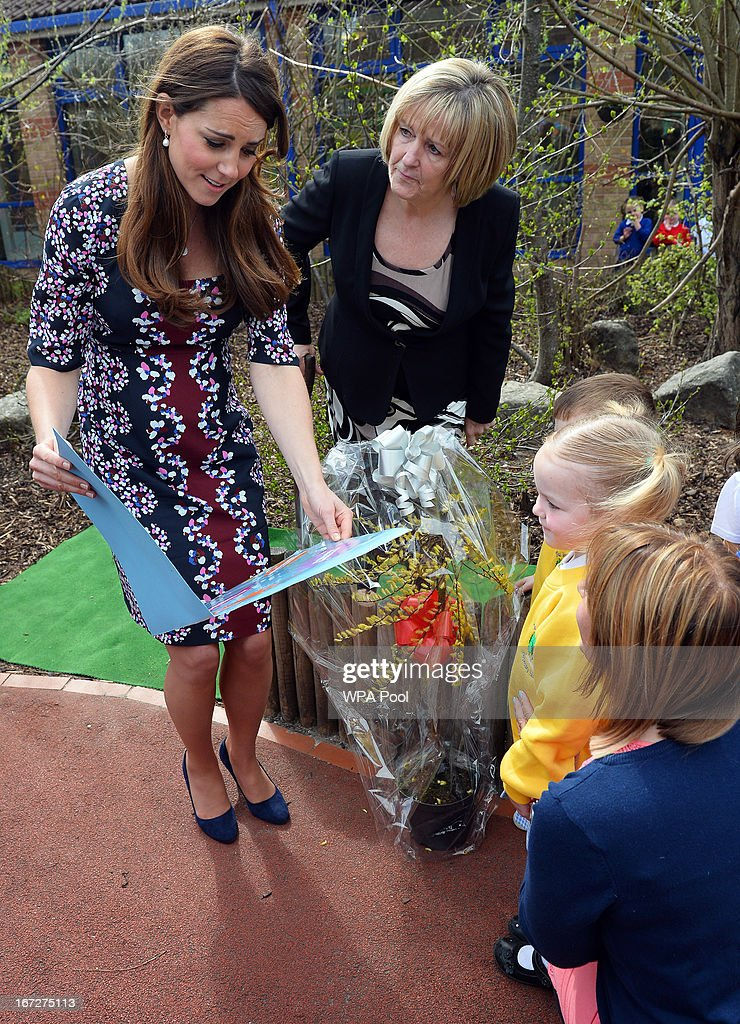 Catherine, Duchess of Cambridge receives a book from nursery children during a visit to The Willows Primary School, Wythenshawe to launch a new school counseling program on April 23, 2013 in Manchester, England. The Duchess of Cambridge met staff and volunteers, teachers and parents at the school as she launched the program which is a partnership between the Royal Foundation, Comic Relief, Place2Be and Action on Addiction.
