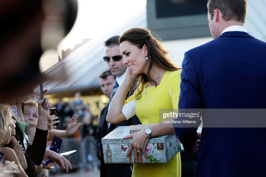 Catherine, Duchess of Cambridge receives a gift from a fan at the Sydney Opera House on April on April 16, 2014 in Sydney, Australia. The Duke and Duchess of Cambridge are on a three-week tour of Australia and New Zealand, the first official trip overseas with their son, Prince George of Cambridge.