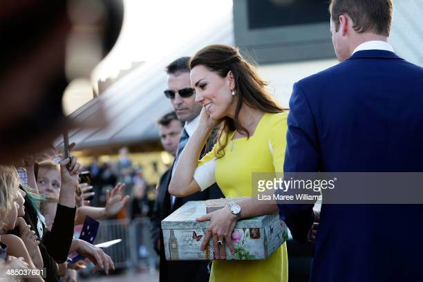 Catherine Duchess of Cambridge receives a gift from a fan at the Sydney Opera House on April on April 16 2014 in Sydney Australia The Duke and...