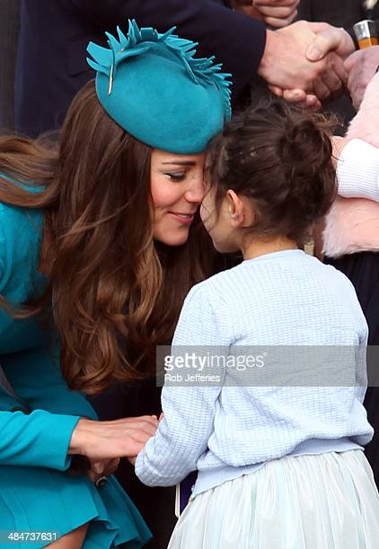 Catherine Duchess of Cambridge receives a hongi from a young fan at the official greeting at Dunedin International Airport on April 13 2014 in...