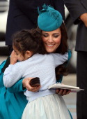 Catherine Duchess of Cambridge receives a hug from a young fan at the official greeting at Dunedin International Airport on April 13 2014 in Dunedin...