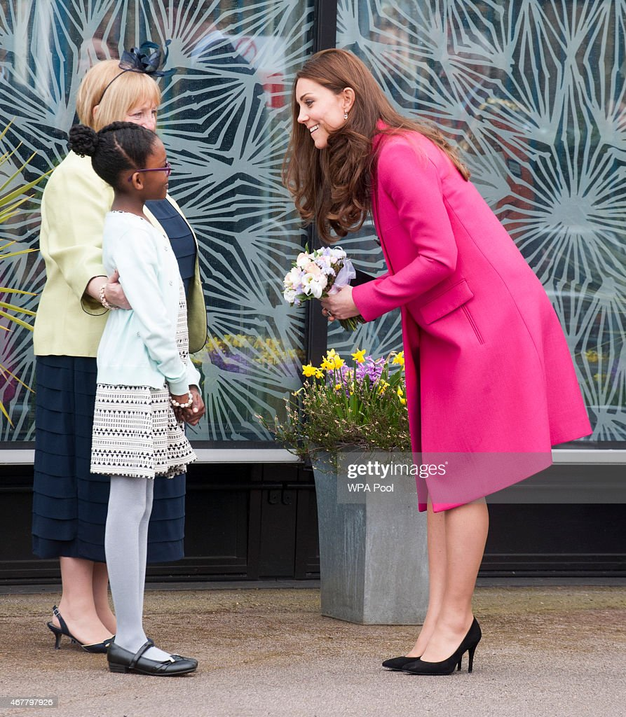 <a gi-track='captionPersonalityLinkClicked' href=/galleries/search?phrase=Catherine+-+Duchess+of+Cambridge&family=editorial&specificpeople=542588 ng-click='$event.stopPropagation()'>Catherine</a>, Duchess of Cambridge receives a posy of flowers from <a gi-track='captionPersonalityLinkClicked' href=/galleries/search?phrase=Stephen+Lawrence&family=editorial&specificpeople=2276544 ng-click='$event.stopPropagation()'>Stephen Lawrence</a>'s niece Mia as she visits the <a gi-track='captionPersonalityLinkClicked' href=/galleries/search?phrase=Stephen+Lawrence&family=editorial&specificpeople=2276544 ng-click='$event.stopPropagation()'>Stephen Lawrence</a> Centre, Deptford during a day of engagements to support development opportunities for young people on March 27, 2015 in London, England.
