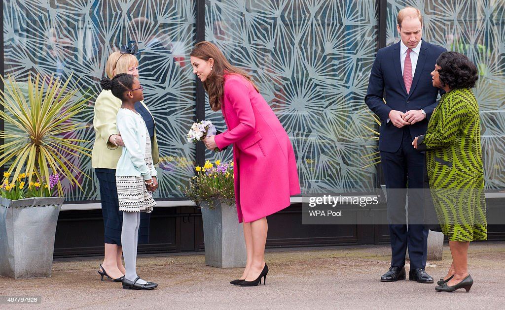 <a gi-track='captionPersonalityLinkClicked' href=/galleries/search?phrase=Catherine+-+Duchess+of+Cambridge&family=editorial&specificpeople=542588 ng-click='$event.stopPropagation()'>Catherine</a>, Duchess of Cambridge receives a posy of flowers from <a gi-track='captionPersonalityLinkClicked' href=/galleries/search?phrase=Stephen+Lawrence&family=editorial&specificpeople=2276544 ng-click='$event.stopPropagation()'>Stephen Lawrence</a>'s niece Mia as <a gi-track='captionPersonalityLinkClicked' href=/galleries/search?phrase=Prince+William&family=editorial&specificpeople=178205 ng-click='$event.stopPropagation()'>Prince William</a>, Duke of Cambridge and Baroness Doreen Lawrence look on during a visit to the <a gi-track='captionPersonalityLinkClicked' href=/galleries/search?phrase=Stephen+Lawrence&family=editorial&specificpeople=2276544 ng-click='$event.stopPropagation()'>Stephen Lawrence</a> Centre, Deptford during a day of engagements to support development opportunities for young people on March 27, 2015 in London, England.