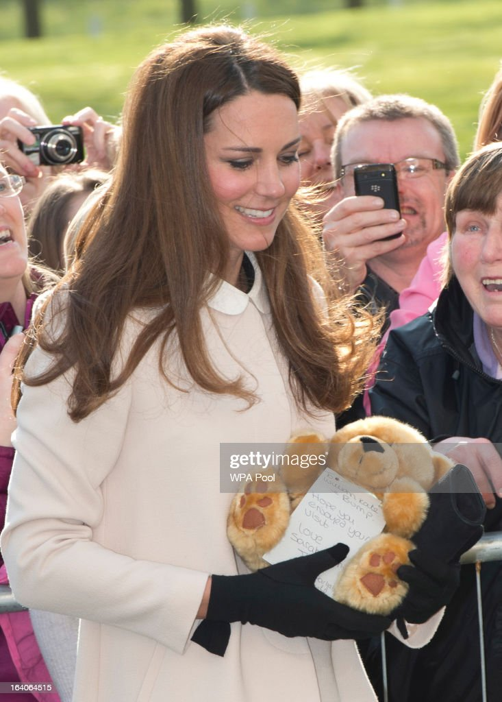 <a gi-track='captionPersonalityLinkClicked' href=/galleries/search?phrase=Catherine+-+Duchess+of+Cambridge&family=editorial&specificpeople=542588 ng-click='$event.stopPropagation()'>Catherine</a>, Duchess of Cambridge receives a teddy bear as she visits the offices of Child Bereavement UK on March 19, 2013 in Saunderton, Buckinghamshire.