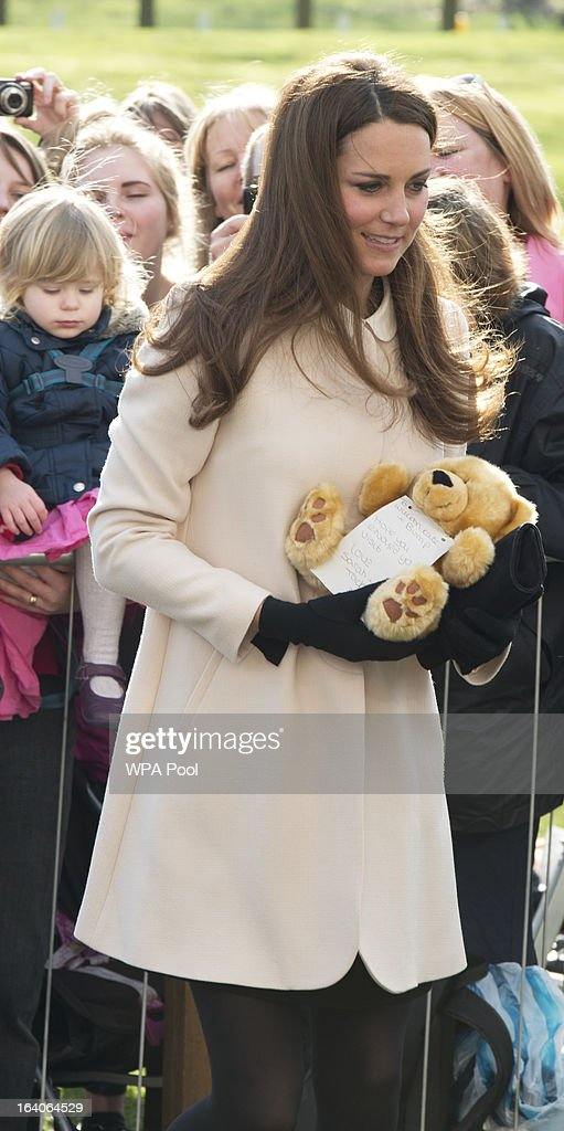 Catherine, Duchess of Cambridge receives a teddy bear as she visits the offices of Child Bereavement UK on March 19, 2013 in Saunderton, Buckinghamshire.
