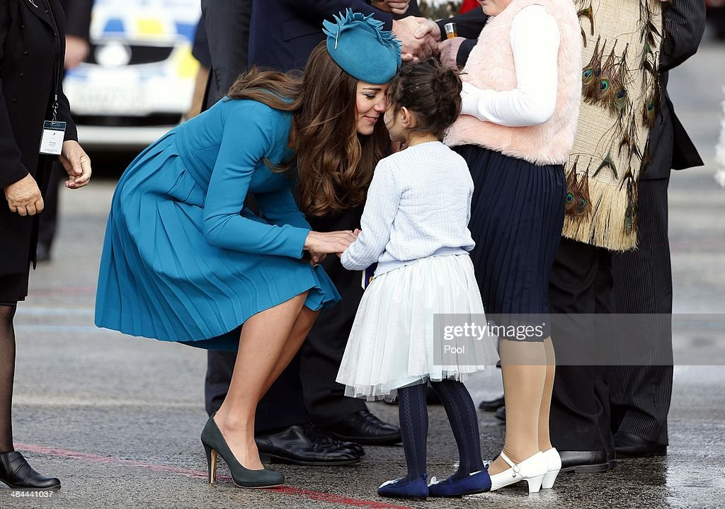 <a gi-track='captionPersonalityLinkClicked' href=/galleries/search?phrase=Catherine+-+Duchess+of+Cambridge&family=editorial&specificpeople=542588 ng-click='$event.stopPropagation()'>Catherine</a>, Duchess of Cambridge receives a traditional Maori welcome called a 'hongi' from five-year-old Mataawhio Matahaere Vieint at Dunedin International Airport on April 13, 2014 in Dunedin, New Zealand. The Duke and Duchess of Cambridge are on a three-week tour of Australia and New Zealand, the first official trip overseas with their son, Prince George of Cambridge.