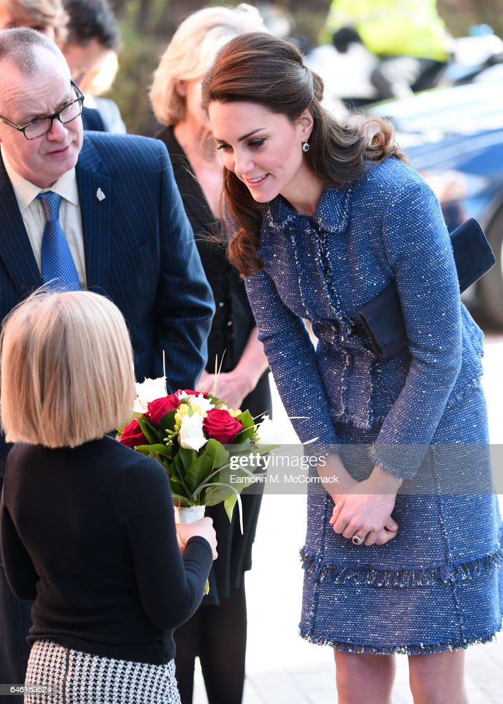 Catherine, Duchess of Cambridge receives flowers during a visit to Ronald McDonald House Evelina London on February 28, 2017 in London, England.
