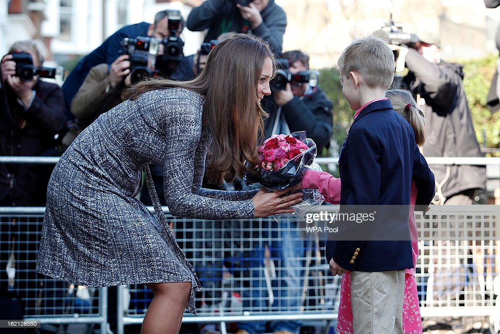 Catherine, Duchess of Cambridge receives flowers from Hugh and Serena Woodford as she visits Hope House residential centre, run by Action on Addiction for recovering addicts on February 19, 2013 in London, England. The Duchess, who is patron of the centre spent over an hour talking to residents at the centre, on her first public engagement since early January.
