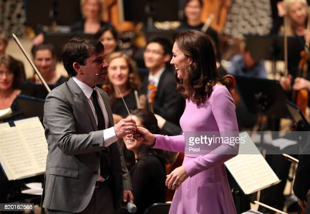 Catherine Duchess of Cambridge receives lessons to conduct an orchestra at Elbphilharmonie during day three of their official visit to Germany after...