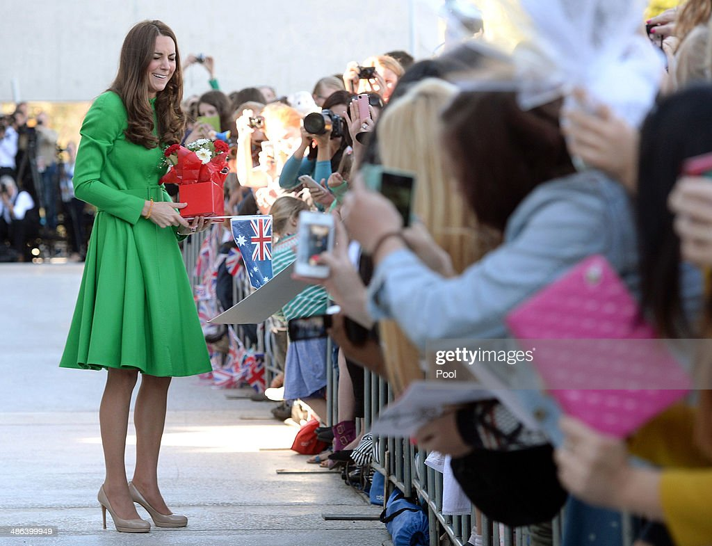 Catherine, Duchess of Cambridge receives presents as she greets the public after visiting the National Portrait Gallery on April 24, 2014 in Canberra, Australia. The Duke and Duchess of Cambridge are on a three-week tour of Australia and New Zealand, the first official trip overseas with their son, Prince George of Cambridge.