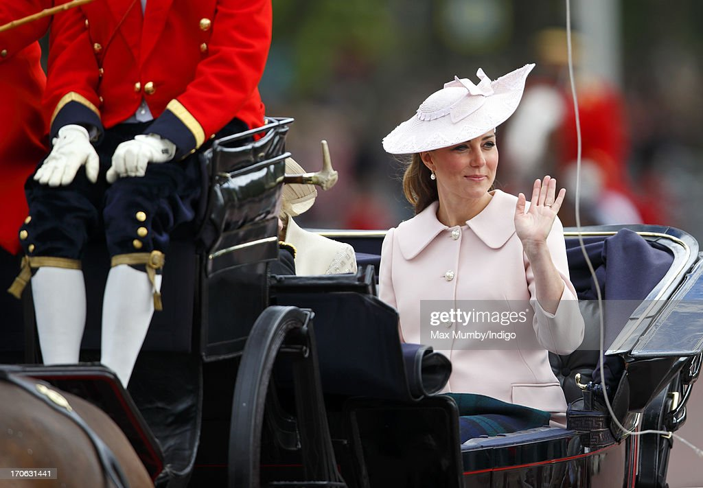 Catherine, Duchess of Cambridge returns to Buckingham Palace in a horse drawn carriage after attending the annual Trooping the Colour Ceremony on June 15, 2013 in London, England. Today's ceremony which marks the Queen's official birthday will not be attended by Prince Philip the Duke of Edinburgh as he recuperates from abdominal surgery. This will also be The Duchess of Cambridge's last public engagement before her baby is due to be born next month.