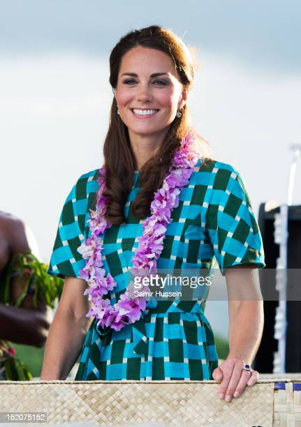 Catherine Duchess of Cambridge rides an opentop vehicle shaped like a traditional canoe at Honiara International Airport on day 6 of the royal...