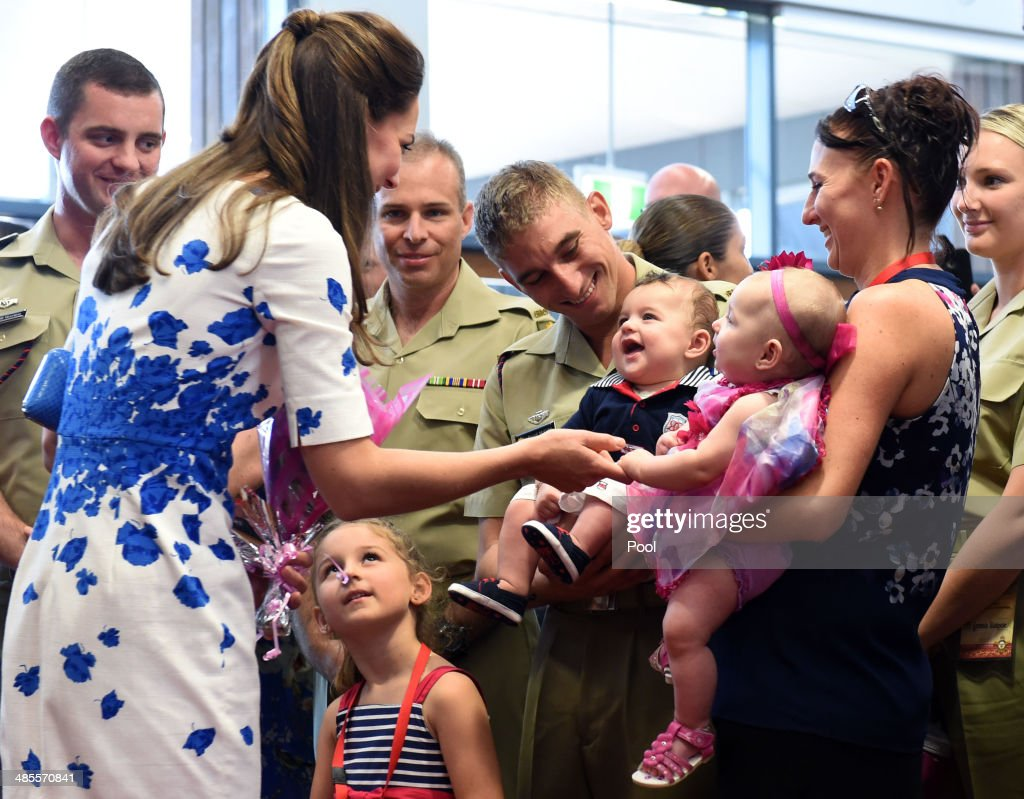 Catherine, Duchess of Cambridge (L) says hello to six-month-old twins Oscar (L) and Alyssa McCabe (R) held by their parents David and Jillian as she meets with families of service personnel at the Royal Australian Airforce Base at Amberley on April 19, 2014 in Brisbane, Australia. The Duke and Duchess of Cambridge are on a three-week tour of Australia and New Zealand, the first official trip overseas with their son, Prince George of Cambridge.
