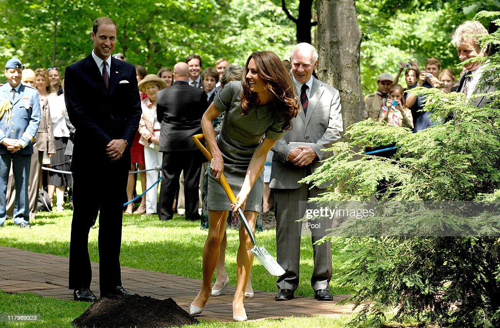 Catherine, Duchess of Cambridge shovels earth during a Tree Planting Ceremony as her husband <a gi-track='captionPersonalityLinkClicked' href=/galleries/search?phrase=Prince+William&family=editorial&specificpeople=178205 ng-click='$event.stopPropagation()'>Prince William</a>, Duke of Cambridge looks on at Rideau Hall on july 02, 2011 in Ottawa, Canada. The tree that the Duke and Duchess help to plant will be next to the one planted by the Prince and the Princess of Wales in 1983. <a gi-track='captionPersonalityLinkClicked' href=/galleries/search?phrase=Prince+William&family=editorial&specificpeople=178205 ng-click='$event.stopPropagation()'>Prince William</a>, Duke of Cambridge and cCatherine, Duchess of Cambridge are on the third day of their first joint overseas tour. Ottawa is the start of a 12 day visit to North America which will take in some of the more remote areas of the country such as Prince Edward Island, Yellowknife and Calgary.